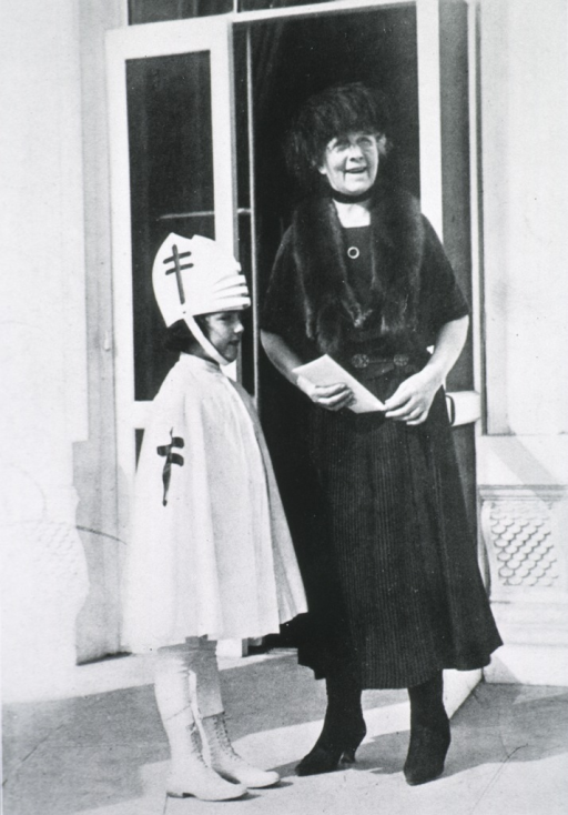 <p>Full length, standing with Red Cross Girl.</p>
