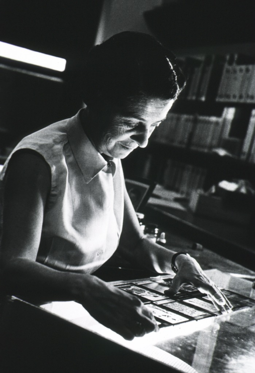 <p>Half-length, seated, right pose; in laboratory, working with slides.</p>