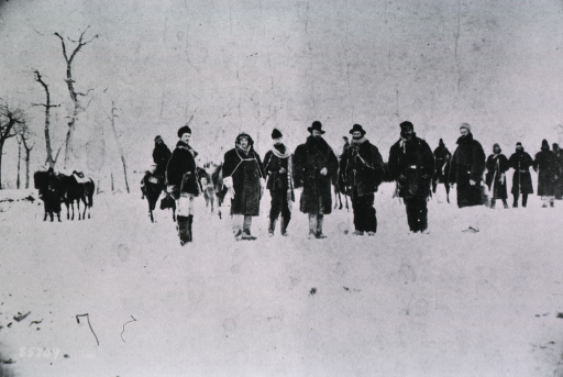 <p>Full length, standing in group, prior to departure of command after Crazy Horse, in Wolf Mountains, Montana.</p>