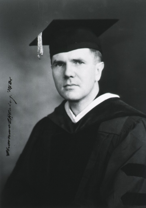 <p>Head and shoulders, left pose, full face; wearing academic gown and cap.</p>