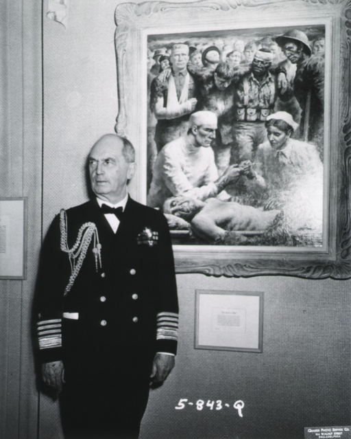 <p>Three-quarter length, front pose, head turned to left; wearing uniform; painting &quot;The Doctor in War&quot; in background.</p>