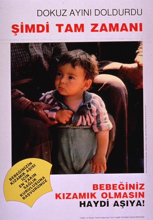 <p>Predominantly white poster with black and red lettering.  Title at top of poster appears to address nine months being exactly the right time.  Visual image is a color photo reproduction featuring a baby standing between the knees of an adult; the adult is not completely visible.  Caption below photo addresses vaccinating a baby against measles.  Additional text may note that vaccination is available at a nearby health center.  Publisher information in lower right corner.</p>