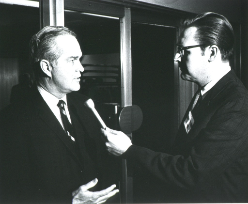 <p>Dr. Robert Marston answers questions for a news reporter.</p>