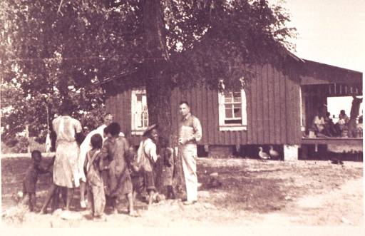 <p>Rural farm with African American family.</p>