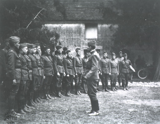 <p>Addressing a group of medical officers of the Third Division, France, 1918.</p>