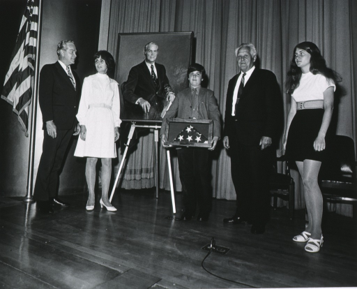 <p>Dr. Robert Marston and family stand with artist Bjorn Egeli at the presentation of Dr. Marston's portrait during his retirement ceremony in April of 1973.</p>