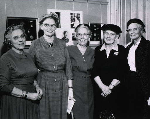 <p>Five women gather at the anniversary tea.</p>