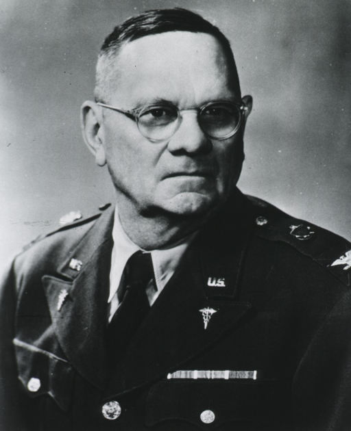 <p>Head and shoulders, left pose, full face; wearing glasses, in uniform of U.S. Army Mc.</p>