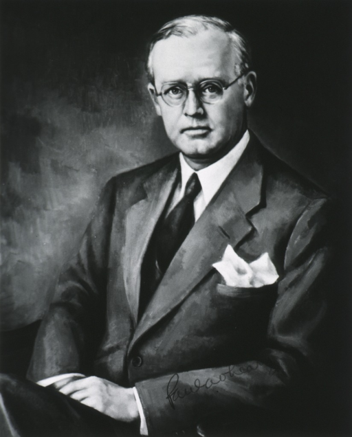 <p>Seated, full face, hands in lap.</p>