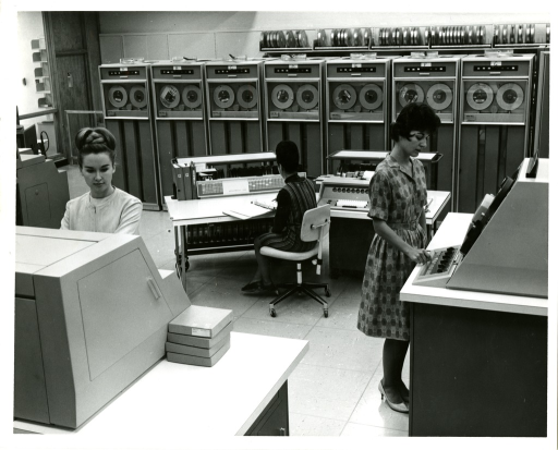 <p>Computer operators and technicians work on programming and utilizing tape driven mainframes in the Office of Computer and Communications Systems (OCCS).</p>