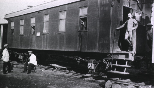 <p>Soldiers(?) are near an officer's car in a medical depot railroad train.</p>