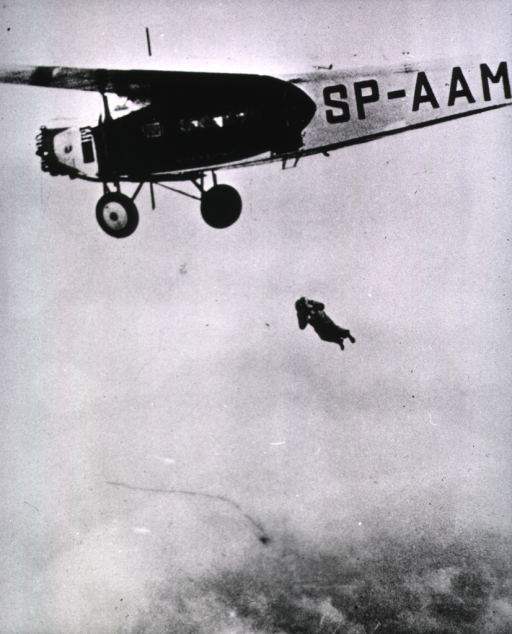 <p>A nurse parachutist, having jumped, is about to open her parachute.</p>