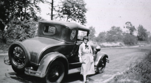 <p>Showing the car on the side of the road and Miss Kramer, the driver.</p>