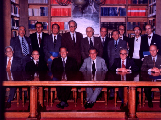<p>Seated from left to right at a long table in a library are previous Jimenez Diaz Award winners: Severo Ochoa of New York University School of Medicine, an unidentified man, Feodor Lynen of Munich University, Francisco Vivanco of Madrid, Hans A. Krebs, Whitley Professor of Biochemistry in the University of Oxford, and Donald S. Fredrickson, director of intramural research at the National Institutes of Health (NIH).  There is a row of ten men standing behind them.</p>