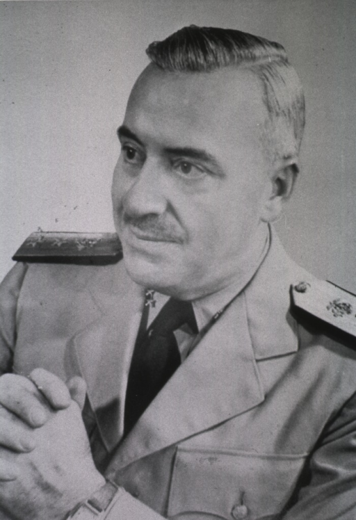 <p>Head and shoulders, left pose, hands together at chest; wearing three-star admiral's uniform.</p>