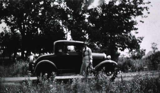 <p>Showing a car by the roadside with Mrs. Smyth as the driver.</p>