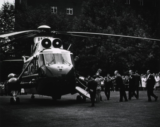 <p>President Johnson is greeted by Surgeon General William Stewart, Dr. James A. Shannon, and Dr. Jack Masur.</p>