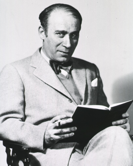 <p>Three quarter length, seated, reading book, right pose, holding cigarette.</p>