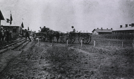 <p>Medical wagons line up along side railroad tracks.</p>