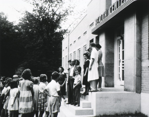<p>Full length, on steps of Greensboro, North Carolina health center, at opening.</p>