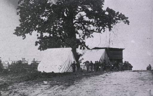 <p>View of soldiers standing in front of tents at White House Landing.</p>