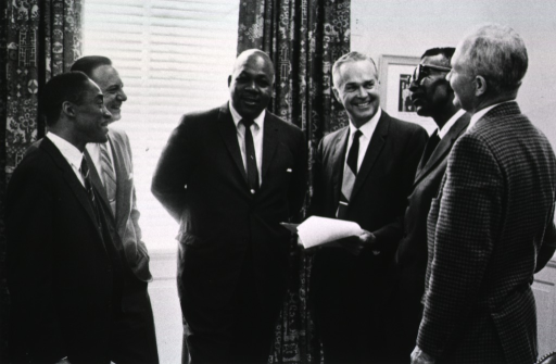 <p>Singing ceremony of an Affirmative Action Plan for Equal Employment Opportunity at NIH.  Those present are Samuel M. Houston, Dr. Colvin L. Gibson, William H. Wiggins, Dr. Robert Marston, Hoover Rowell, and John M. Sangster.</p>