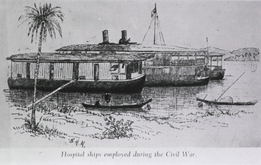 <p>Exterior view of two, anchored in river.</p>