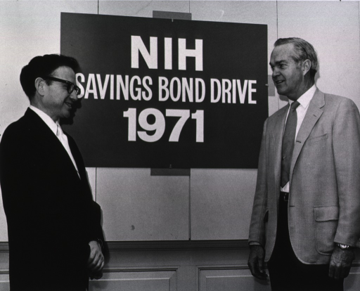 <p>Dr. Robert Marston and Dr. Theodore Cooper meet to discuss the NIH Savings Bond Drive.</p>