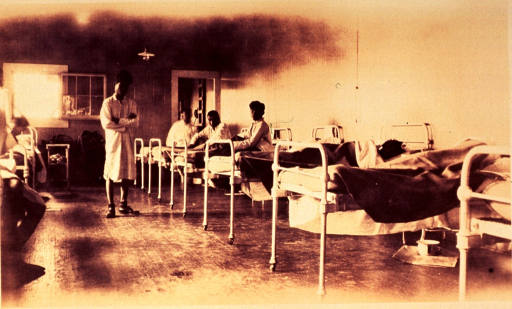 <p>Interior of a ward with patients in bed.</p>