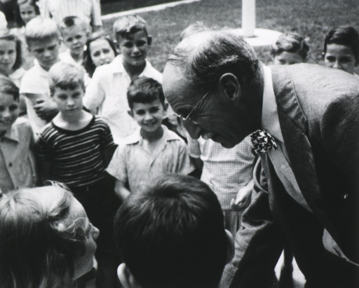 <p>Half length, left profile, smiling at a group of children, probably at the opening of a Greensboro, North Carolina Health Center.</p>