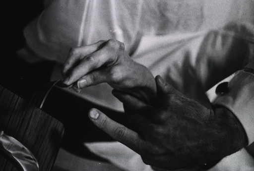 <p>Therapist's hands holding the wrist of a patient with rheumatoid arthritis; the patient is attempting to use a fork.</p>