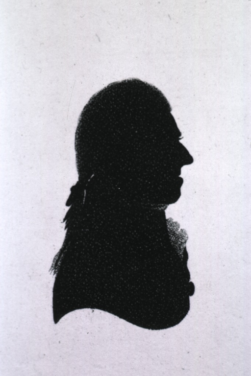 <p>Silhouette, head and shoulders, right profile.</p>