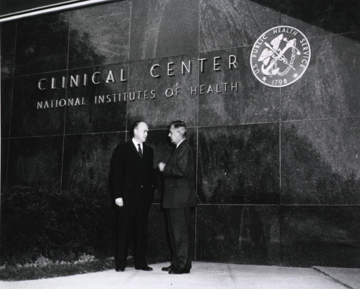 <p>Showing Congrassman Laird and Dr. James Watt outside Clinical Center.</p>