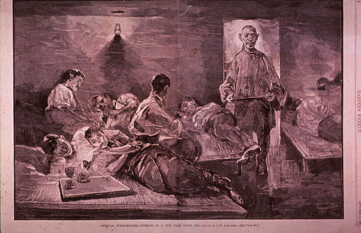 <p>Interior view of an opium den.  Several people, sitting and lying on cots scattered about the room, are smoking opium; an oriental man has entered the room carrying a tray with a glass on it.</p>