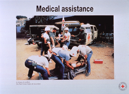 <p>White poster with black lettering.  Title at top of poster.  Visual image is a reproduction of a color photograph showing Red Cross personnel attending to two wounded men.  One man is being carried in a worker's arms.  The other lies on the ground on a collapsed gurney.  Caption below photo.  Red Cross logo in lower right corner.</p>