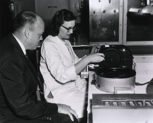 <p>Congressman Laird watches Jane Jable cut fine sections of animal brain tissue on a microtome.</p>