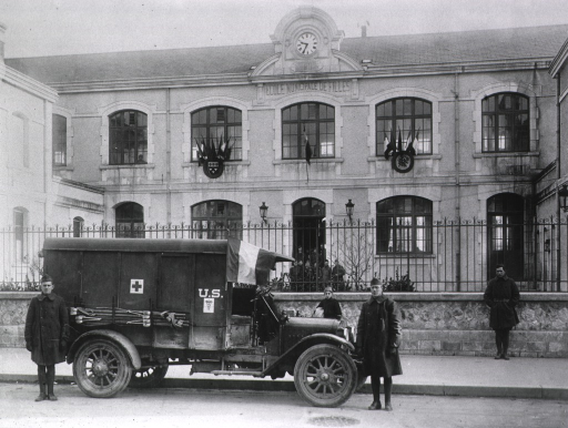 <p>Exterior, showing Red Cross ambulance.</p>