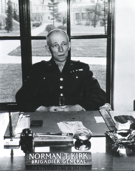 <p>Half-length, seated at desk, full face; wearing uniform; window in background.</p>