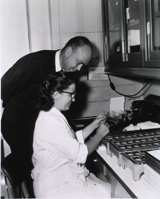 <p>Congressman Laird observes the technique used in mounting tissue sections on slides demonstrated by Elena Baker in the Laboratory of Neuroanatomical Sciences of the National Institute of Neurological Diseases and Blindness.</p>