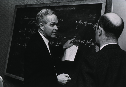 <p>Dr. Marston makes a point with a fellow researcher.</p>