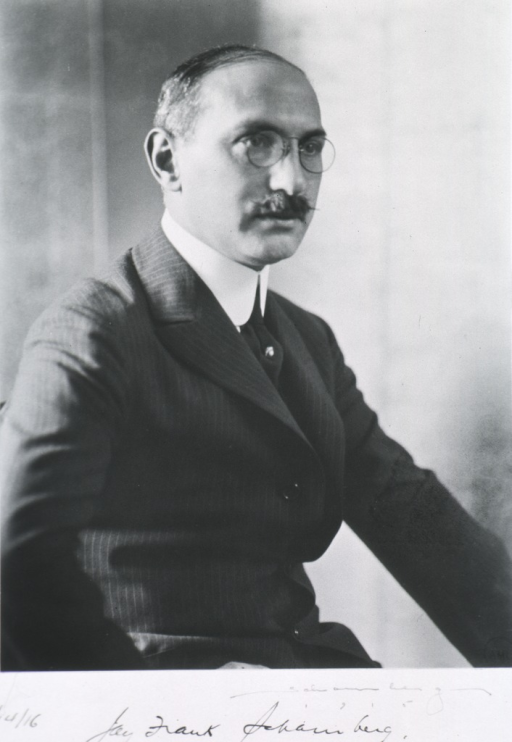 <p>Seated, right pose; wearing glasses.</p>