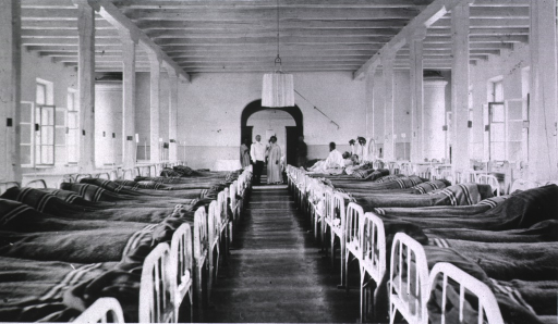 <p>Two nurses, a physician, two medical personnel, and a few patients in a ward at Military Hospital No. 3.</p>