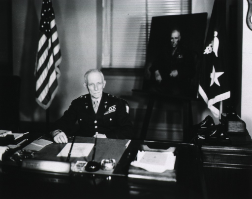 <p>Half-length, seated at desk, full face; wearing uniform; portrait on easel in background.</p>