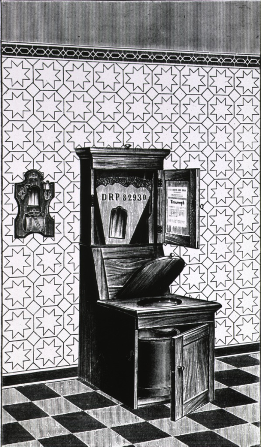 <p>A wooden toilet with hinged opening beneath the seat for the removal of a bucket.</p>