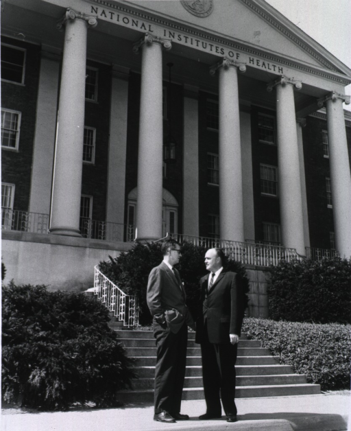 <p>Congressman Laird pauses to chat with Dr. James A. Shannon, Director of the National Institutes of Health, in front of the NIH Administration Building.</p>