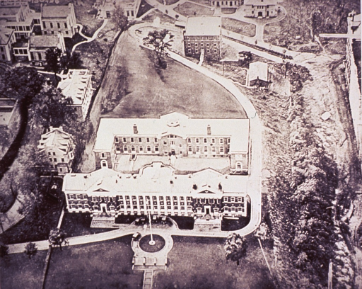 <p>Aerial view showing buildings of the PHS, National Institute of Health, on the grounds of the old Naval Observatory at 25th and E Streets, N.W., Washington, D.C.  The larger building with the circular drive is the North building; the building behind it is the South building.</p>