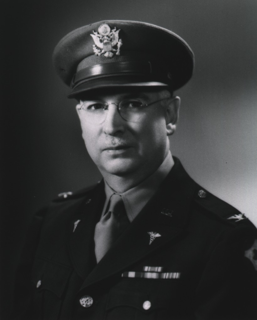 <p>Head and shoulders, full face, wearing cap and uniform (Colonel).</p>