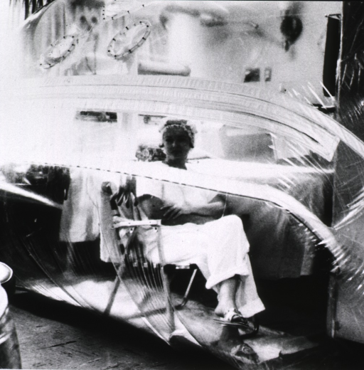 <p>Interior view: a woman is sitting in a large plastic capsule which provides the germ-free environment needed as a result a weakened immune system due to treatment with immuno-suppressive drugs.</p>