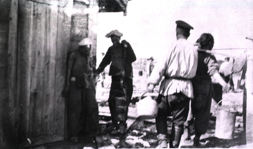 <p>A soldier carries a jug outside of the hot water building while one of the three servants has buckets hung over his shoulders.</p>