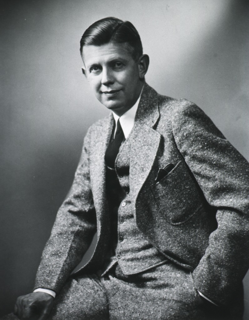 <p>Three quarter-length, seated, left pose, full face; hand on leg; other hand in pocket.</p>